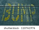 Speed Bump Sign Painted On The...