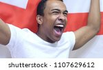 english fan celebrating while... | Shutterstock . vector #1107629612