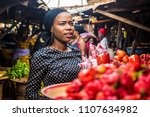 a girl in a typical local... | Shutterstock . vector #1107634982