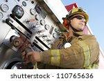 firefighter holding hose | Shutterstock . vector #110765636