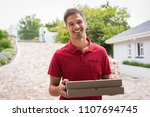 smiling young delivery man... | Shutterstock . vector #1107694745
