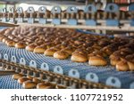 cakes on automated round... | Shutterstock . vector #1107721952