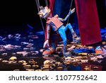Small photo of Wooden Pinocchio doll walks around the sawdust