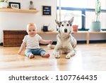 baby girl sitting with husky on ... | Shutterstock . vector #1107764435