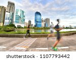 people running in the evening... | Shutterstock . vector #1107793442