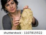 sculptor artist creating a bust ... | Shutterstock . vector #1107815522