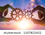 two hands connect the gears ... | Shutterstock . vector #1107822422