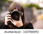 woman taking a photo in the... | Shutterstock . vector #110784092