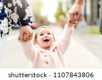 young girl holding hands with... | Shutterstock . vector #1107843806