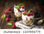 white yogurt with muesli and... | Shutterstock . vector #1107856775