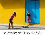man taking a photo of a girl in ... | Shutterstock . vector #1107861992