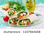 burritos wraps with chicken and ... | Shutterstock . vector #1107864608
