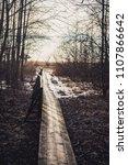 wooden foot bridge in winter ... | Shutterstock . vector #1107866642