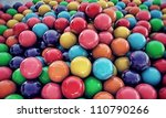 large group of gumballs on concrete floor - stock photo