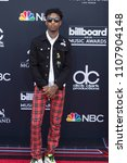 Small photo of Rapper 21 Savage attends the Red Carpet at the 2018 Billboards Music Awards at the MGM Grand Arena in Las Vegas, Nevada USA on May 20th 2018