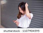 young thai university student... | Shutterstock . vector #1107904595