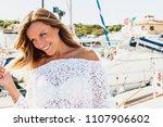 beautiful blond woman walking...   Shutterstock . vector #1107906602