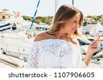 beautiful blond woman walking... | Shutterstock . vector #1107906605