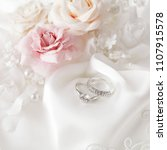 wedding rings and flowers | Shutterstock . vector #1107915578