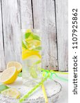 fresh cold mojito cocktail with ... | Shutterstock . vector #1107925862