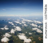 Sky from airplane, view to the earth with fields and clouds - stock photo