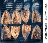 Small photo of Fish Smoking Process. Smoked Mackerel and flounder. Close Up Smoking. Top view