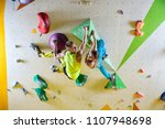 cheerful rock climbers in... | Shutterstock . vector #1107948698