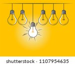 set of hanging light bulbs with ... | Shutterstock .eps vector #1107954635