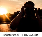 silhouette of young man with... | Shutterstock . vector #1107966785