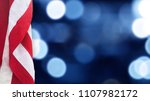 american flag with blue bokeh... | Shutterstock . vector #1107982172