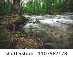 tree next to fast flowing...   Shutterstock . vector #1107982178