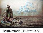 eid mubarak with date palm...   Shutterstock . vector #1107993572