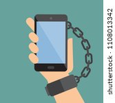 hand chained to the smart phone.... | Shutterstock .eps vector #1108013342