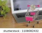 silver coin on shopping cart... | Shutterstock . vector #1108082432