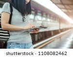 young woman traveler using... | Shutterstock . vector #1108082462