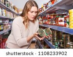 serious female in the shop... | Shutterstock . vector #1108233902