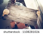 contractor with large wooden... | Shutterstock . vector #1108281026