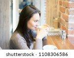 beautiful young woman drinking...   Shutterstock . vector #1108306586