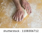 male hands preparing dough for...   Shutterstock . vector #1108306712