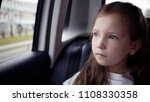 little girl looking out from... | Shutterstock . vector #1108330358