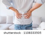 man is touching his back... | Shutterstock . vector #1108333505