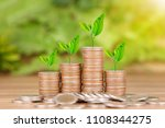 tree growing on coins stack... | Shutterstock . vector #1108344275