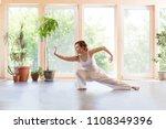 young woman praticing tai chi... | Shutterstock . vector #1108349396