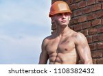 builder with muscular torso and ... | Shutterstock . vector #1108382432