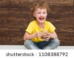 the kid drinking cocoa at home. | Shutterstock . vector #1108388792