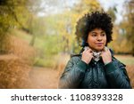 young woman at the autumn park  ... | Shutterstock . vector #1108393328
