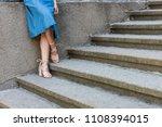 cropped shot of woman in denim... | Shutterstock . vector #1108394015
