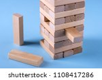 Small photo of A reliable steady design from wooden sticks of the designer as a conceptual basis of creation of business plans or business administration