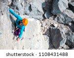 mountaineer in helmet. a woman...   Shutterstock . vector #1108431488