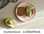 avocado on toast on a plate | Shutterstock . vector #1108609646